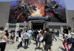 The first riders enter Transformers: The Ride